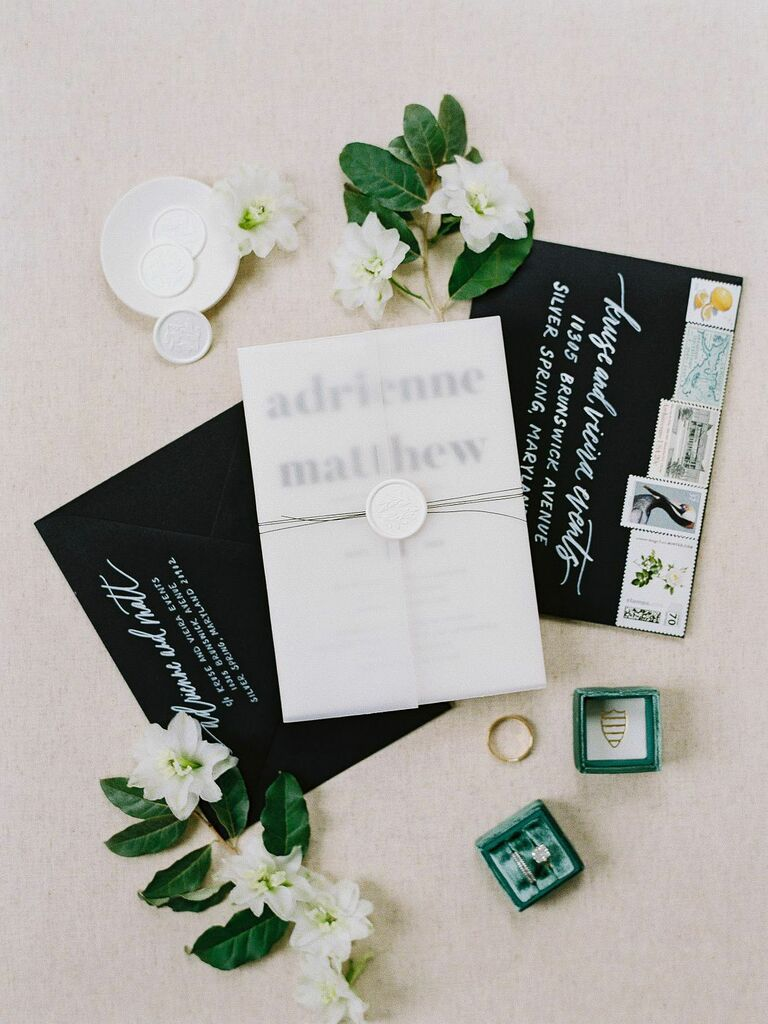 Black and white modern wedding invitation suite flat lay