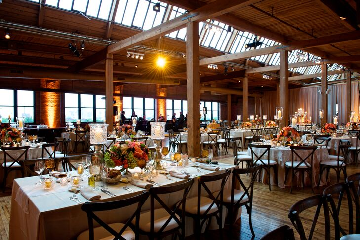 """Brielle and Jonathan wanted a venue that would pay homage to their hometown and city where they fell in love: Chicago. Bridgeport Art Center was the very last venue they visited. """"As soon as we walked in, Jonathan and I gave each other the 'we are definitely getting married here' look,"""" says Brielle. """"The brick walls, rich wood floors and columns and windows showcasing a skyline view were everything I had hoped for."""""""
