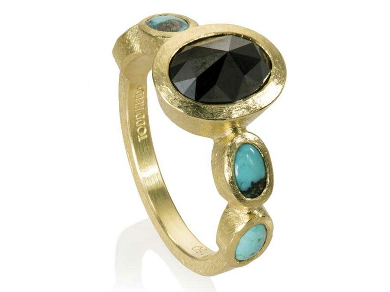 Oval black diamond ring with oval cabochon turquoise side stones
