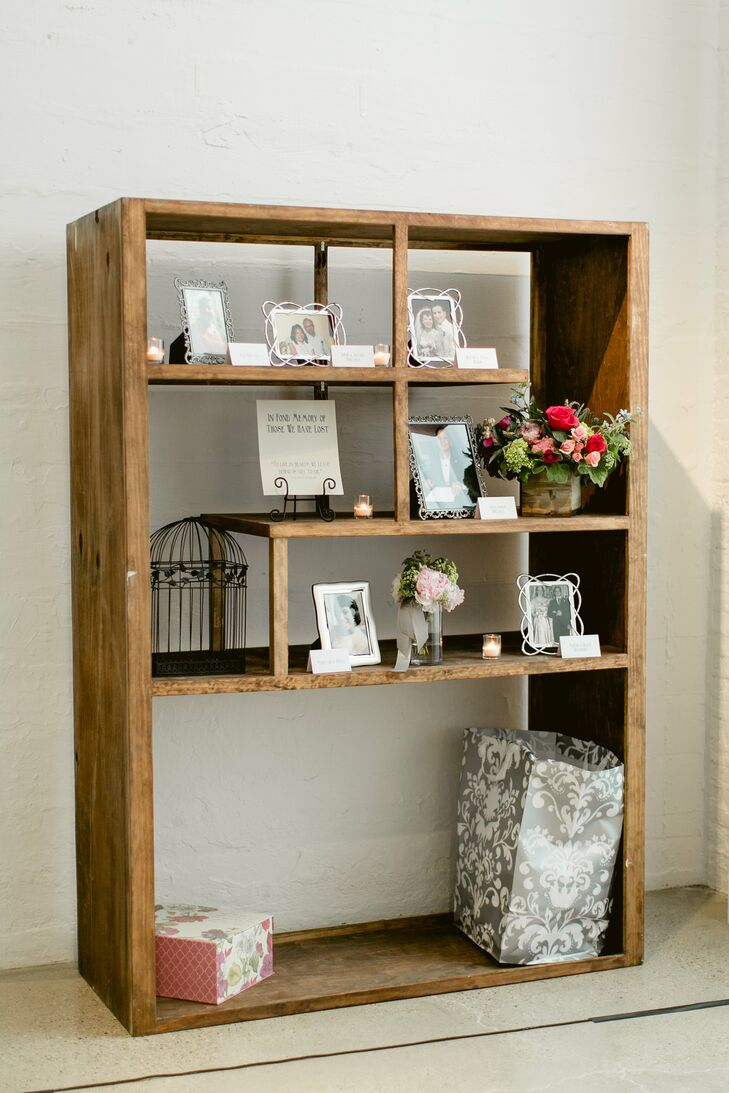 """A photo display of family members who had died—including Jav's mother and godmother—was set up near the gift area. In addition to framed photos, tealights and floral arrangements, this quote was also on the shelf: """"To live in hearts we left behind is not to die."""""""