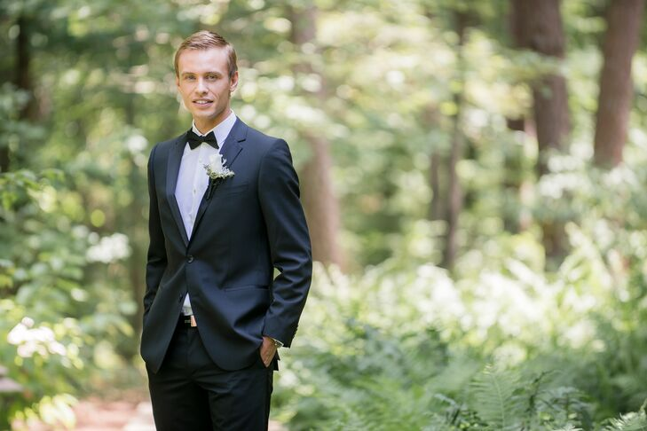 Etienne wore a black tuxedo with a black bow tie and white boutonniere.