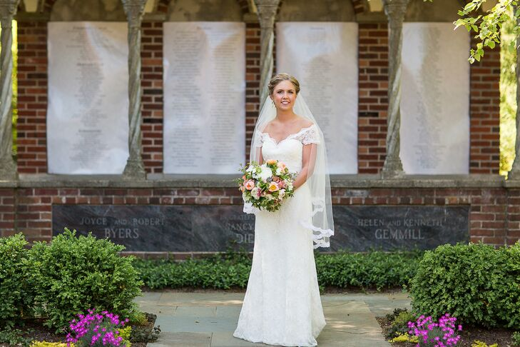 Liz wore a lace WTOO dress with off-shoulder cap sleeves. She paired her dress with a waltz-length, lace-trim veil.