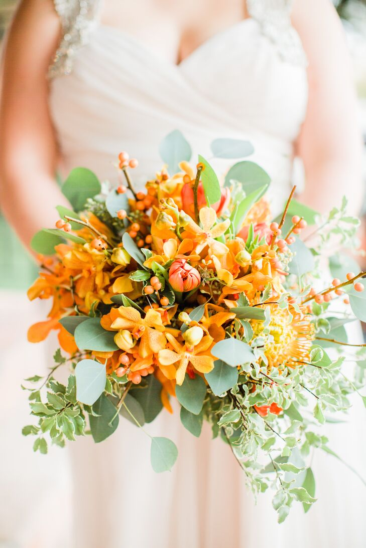 Orange orchids are Alison's favorite flower, so her florist, SCF Events, highlighted these in her fall-inspired bouquet. The arrangement also had orange hypericum berries, eucalyptus and ivy.