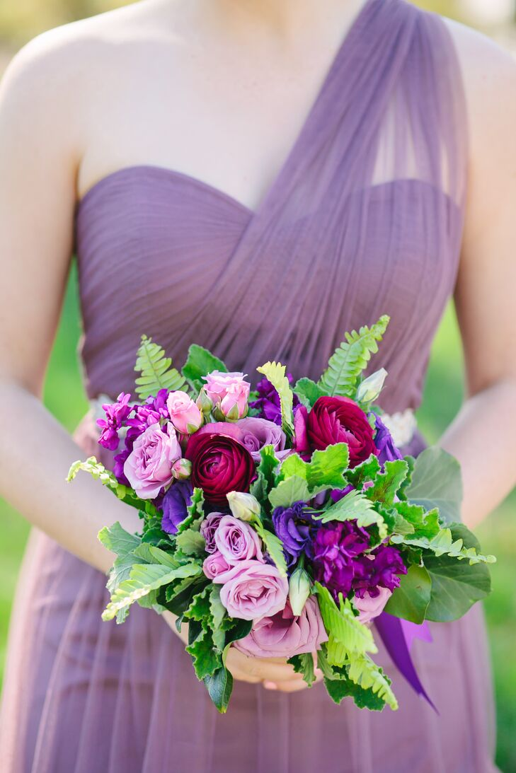 The bridesmaids held purple bouquets filled with rich purple roses, stock and lisianthus, plus accents of fern and hypericum berries. The flower arrangements matched the bridesmaid dresses wonderfully.