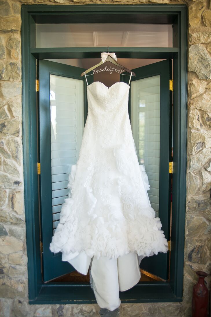 Lauren found her strapless A-line gown with tulle rosettes at a consignment shop.
