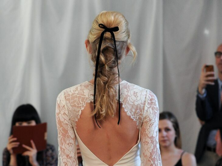 Wedding updo fishtail with bow