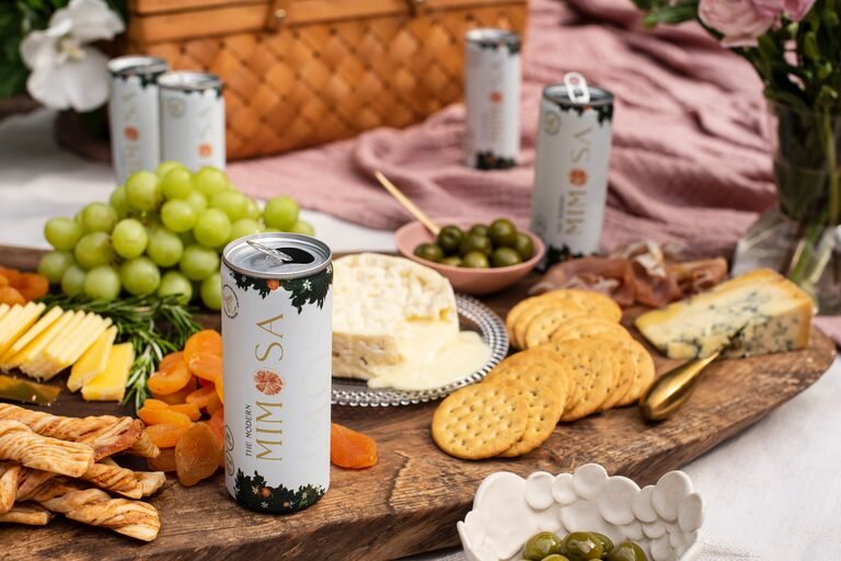 canned mimosa drink charcuterie cheese board