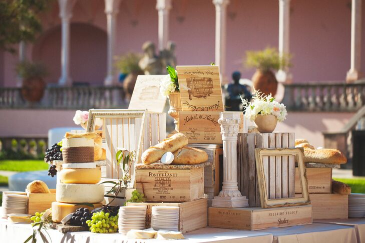 The couple incorporated the Gulf Coast Cheese Fest where they first met and their mutual taste for wine into the reception. Rolls of cheese, baguettes and various vintages of wine in crates were used as accents during the reception.