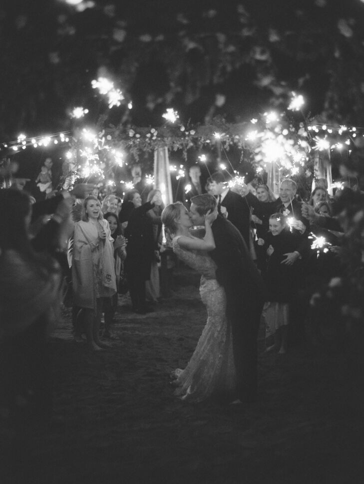 "At the end of the night, Eliza and Jason exited through sparklers. ""Since Jason and I grew up together, all our closest friends are the same,"" Eliza says. ""Our wedding felt more like a family reunion or a small party than a formal wedding."""