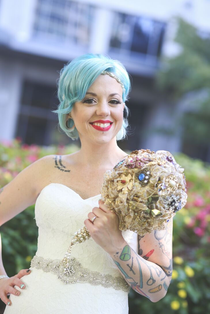For her bouquet, the bride completely covered a gold lace doily with vintage broaches that were passed down from family and friends.