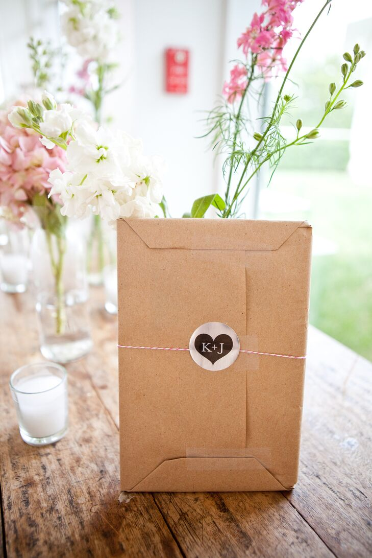 Kelley and Jeff chose a wedding favor that guests could continue to use in the years to come: a mini recipe book. Each was wrapped in brown paper and set in a neutral woven basket by the reception entrance at the Garrison in Garrison, New York.