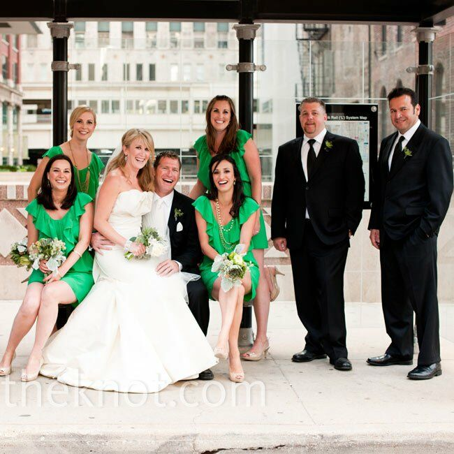 The bridesmaids, wearing ruffled kelly green dresses, stood out against the 