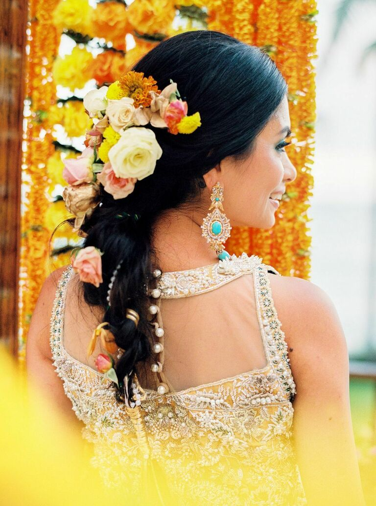 Bride with yellow flowers in braided updo