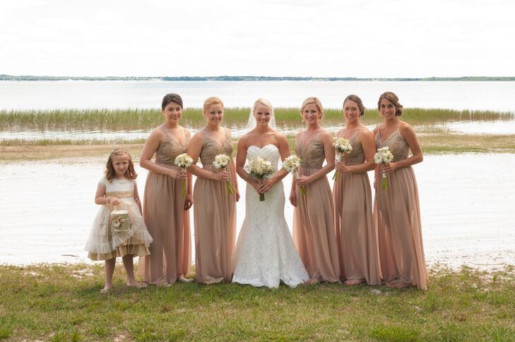 After searching through a few styles on TheRedDressBoutique.com, Holly found long bridesmaid dresses that fit their rustic decor. Each woman wore a neutral chiffon dress with a long fabric overlay, embroidered bodice and neutral shoes.