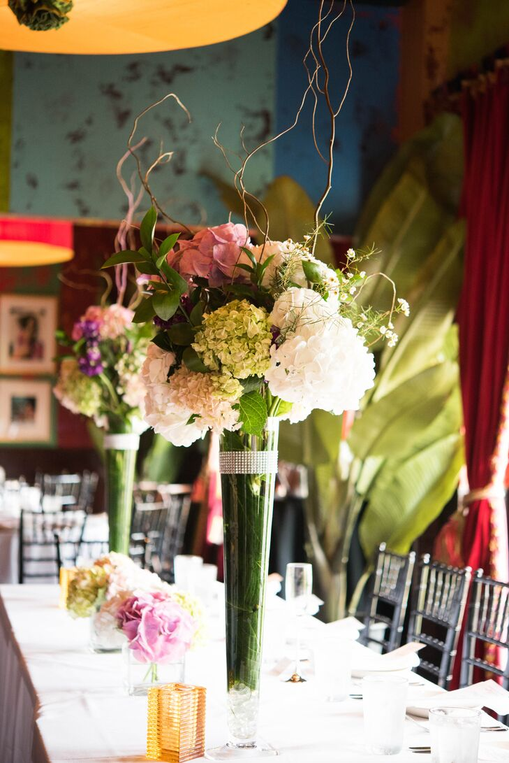 Green and white arrangements of hydrangeas were used to create dramatic centerpieces that topped each dining table.