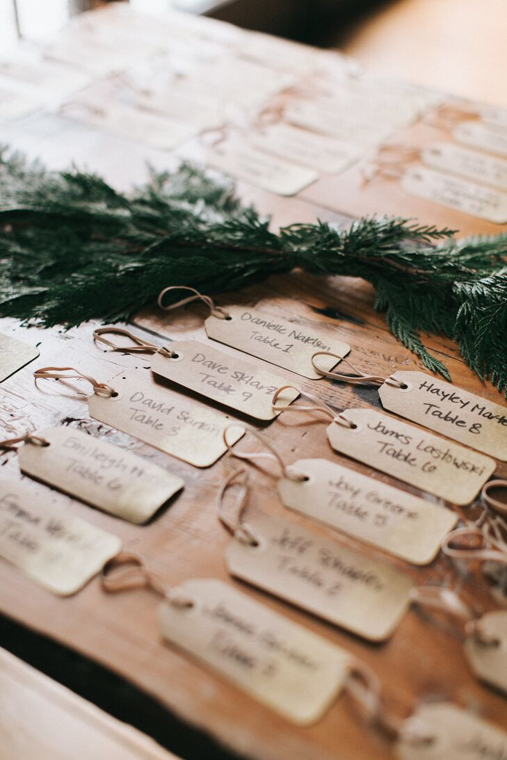 To help their family and friends find the way to their seats, Shane and Lexie wrote guests' names and tables on vintage-inspired gift tags that complemented the evening's rustic-chic theme.