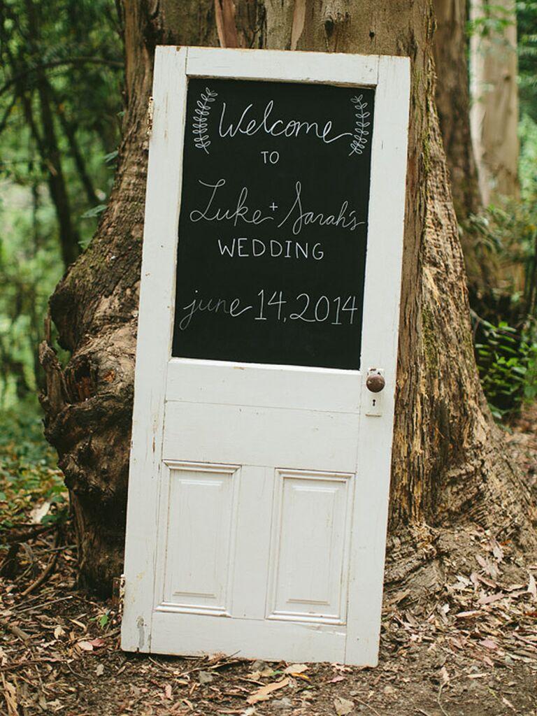 DIY rustic doorframe repurposed for a wedding sign