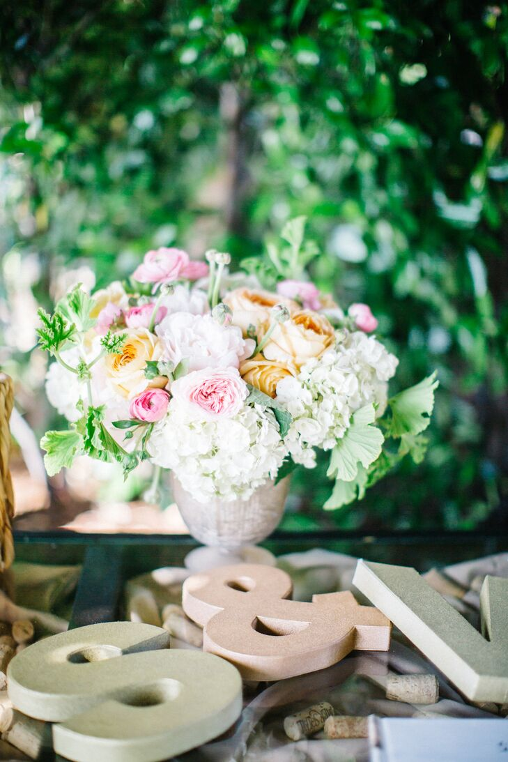 Tesoro Flowers of Sonoma, California, helped bring Samantha's Pinterest-inspired floral concepts to life. Centerpieces were a softly colorful combination of cream hydrangeas, greenery and blush and gold peonies.