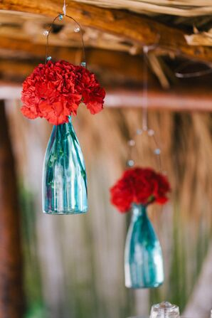 Hanging Red Flowers Blue Vases