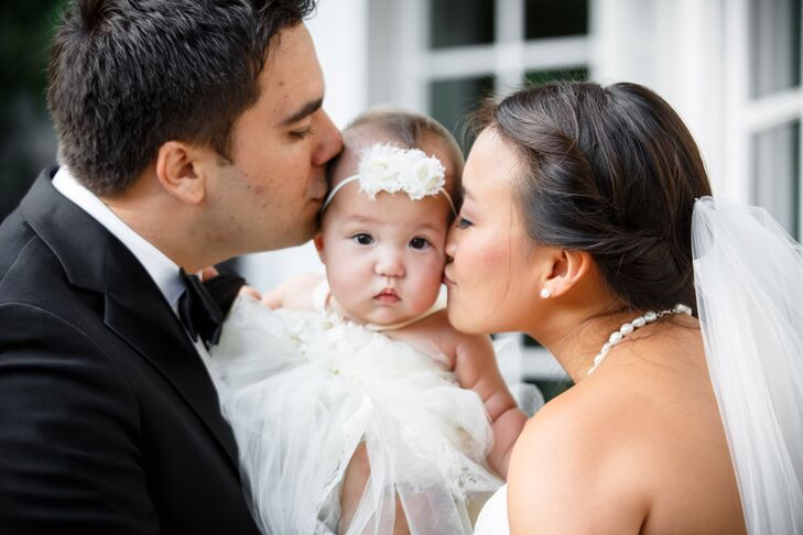 Jen and Eddie Kissing Their Baby