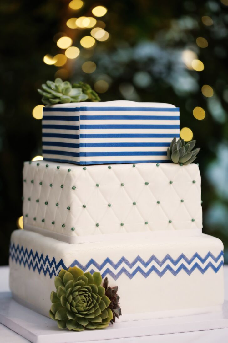 Salt City Bakery created Courtney and John's contemporary three-tier cake with modern patterns such as stripes and chevron, which were used throughout the reception.