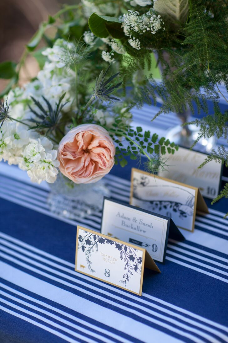 White escort cards had navy designs printed of them, and were bordered with gold or blue.