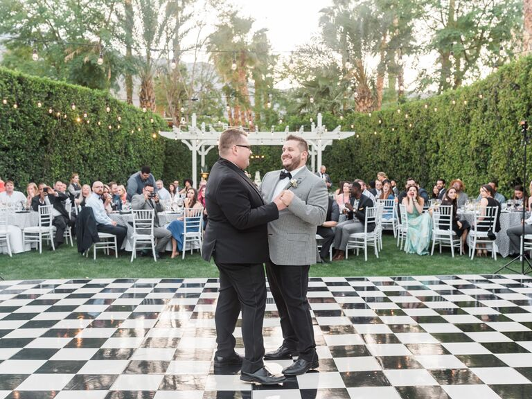 Same sex couple grooms first dance at reception