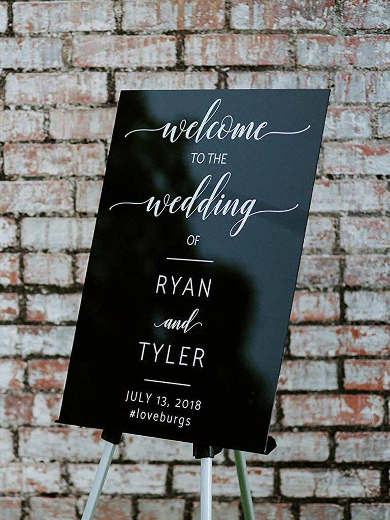 Black wedding welcome sign with calligraphy