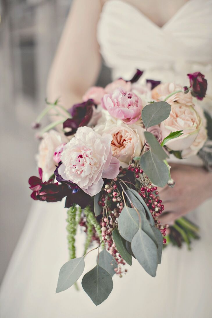 Emily carried a lush gathering of pink peonies and garden roses combined with burgundy ranunculus and berries.