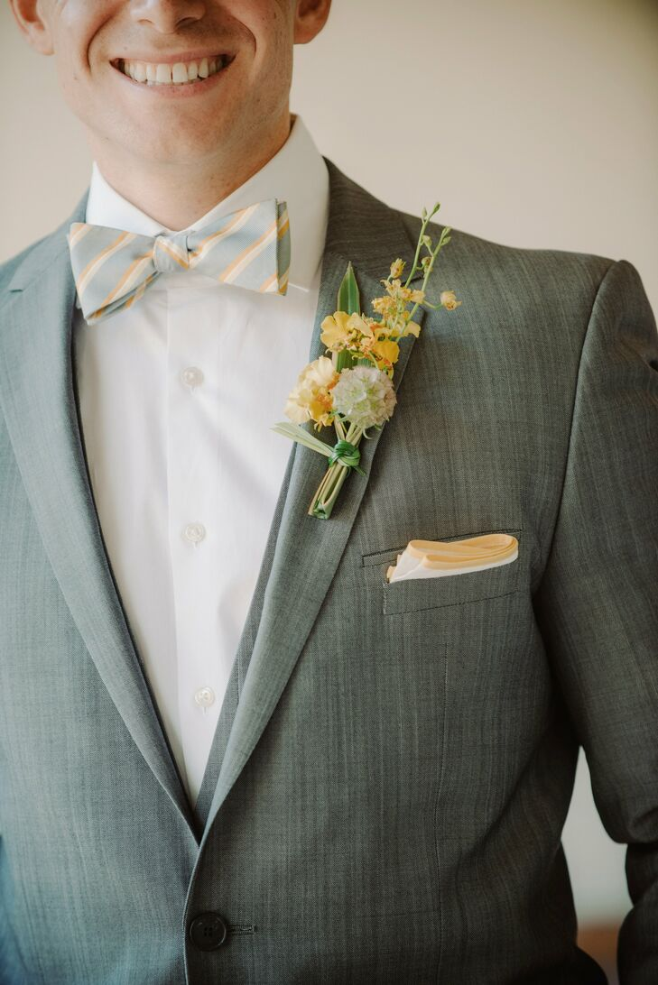 Mike's rustic yellow boutonniere made the stripes in his bow tie pop.