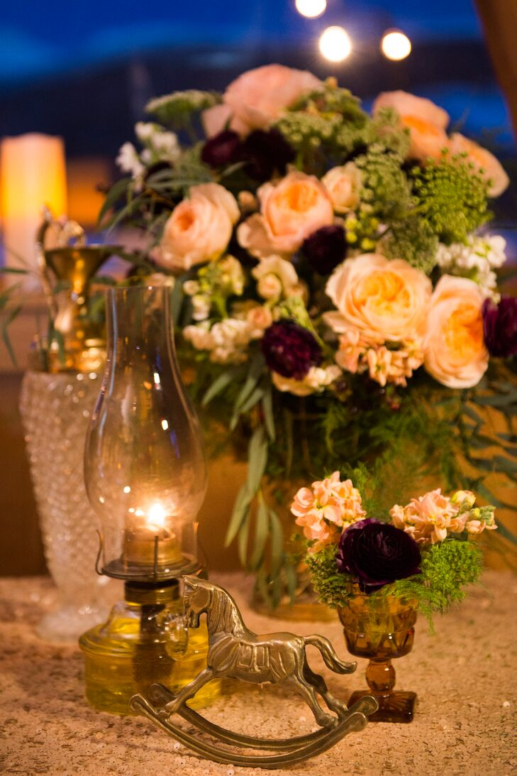 To match the whimsical fox caricature invitations, Kristen and Sean added gold animal figurines to their centerpieces