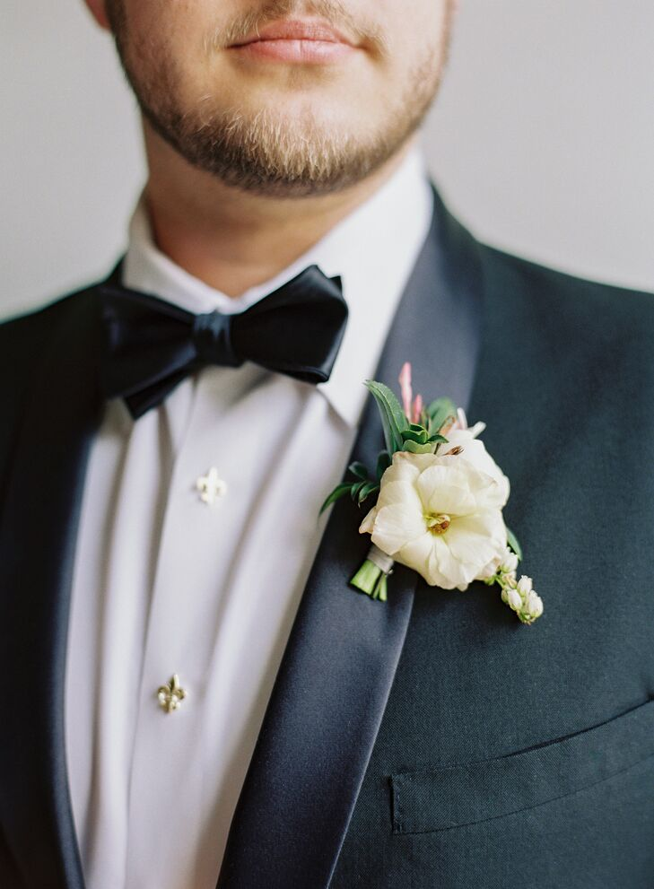 Classic White Boutonniere with Black Bow Tie