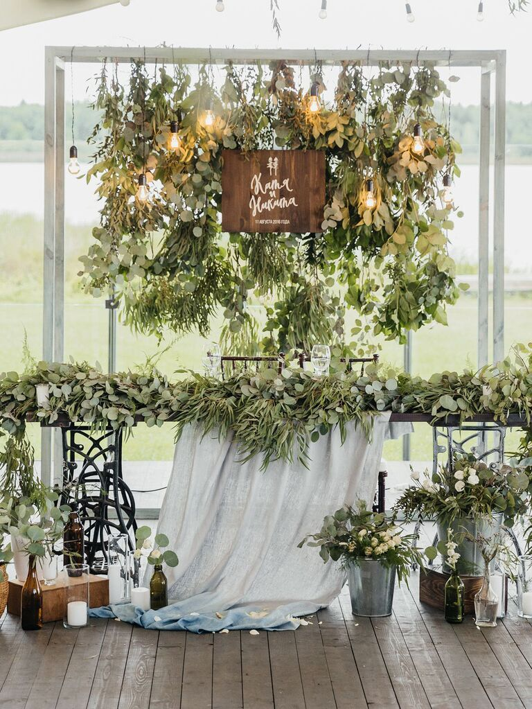 rustic wood sign and sweetheart table décor