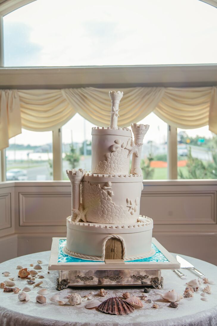 Kristie and Kyle's love for the beach definitely came out in their wedding cake design. Made at Carlo's Bakery, their three-tier confection resembled a sandcastle with ornate sugar starfish, a stone wall design and three turrets. A blue design resembling a moat even accented its base.