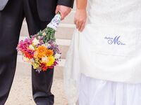 Bride with monogrammed wedding dress
