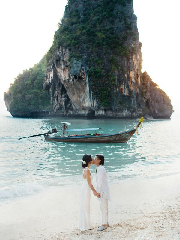 Couple kissing on the beach in Thailand