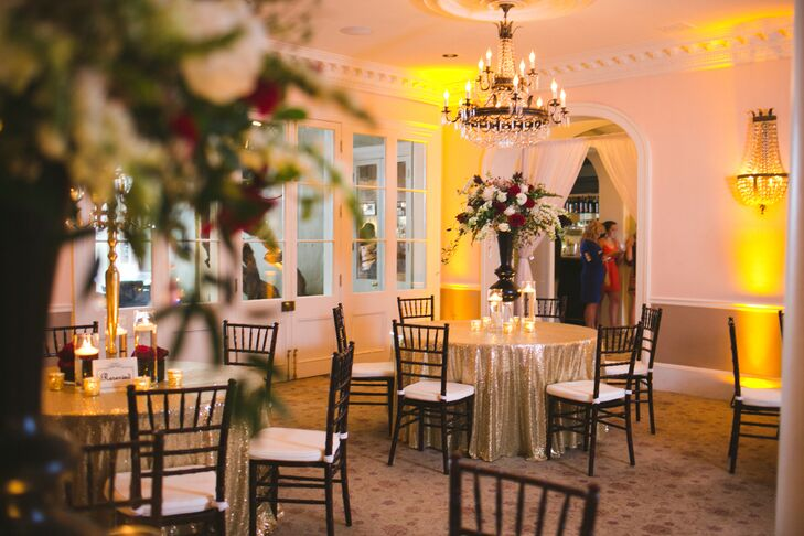 Gold-threaded tablecloths, black Chiavari chairs and tall floral centerpieces produced a modern, glamorous look.