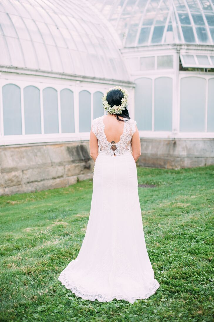 April wore an ivory silk Rania Hatoum wedding dress purchased from Glitter & Grit, accented with lace on the back and bordering the bottom and train.