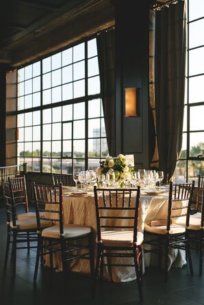 Round Table with Brown Wood Chiavari Chairs