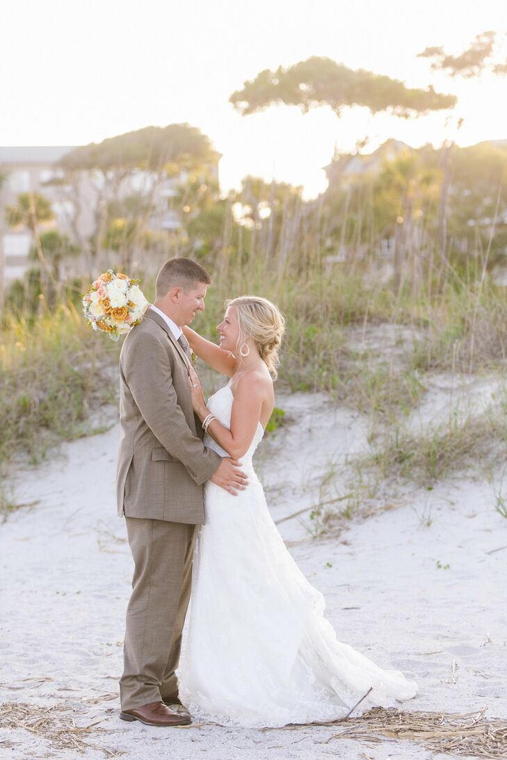Drawing inspiration from their beach location, Holly and Jordan planned an elegant, rustic bash with a peach, ivory and gold color palette.