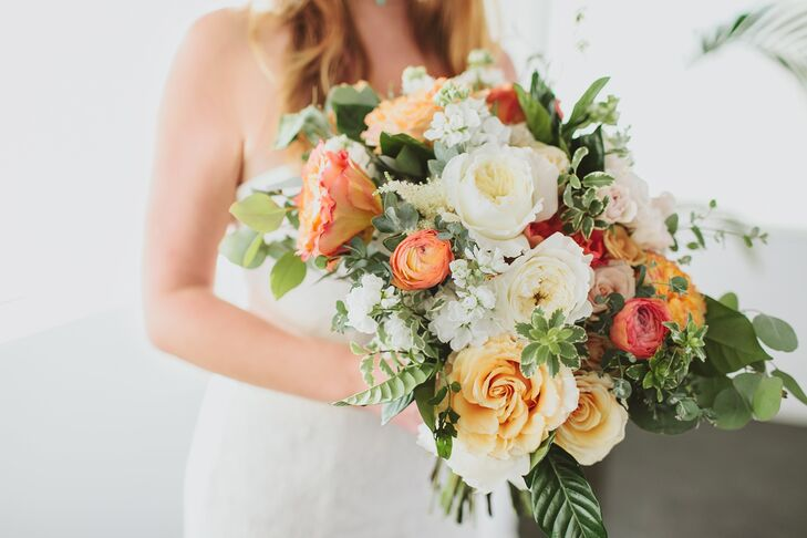 """I wanted a boho beach wedding with rich orange sunset colors in the flowers,"" says Gwynne, whose florist, The Little Branch, created a fiery peach and ivory bouquet from garden roses."