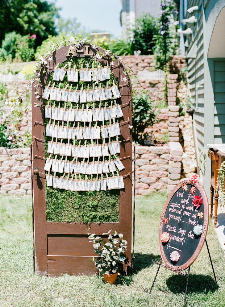 Shelby took a vintage door, covered the center in moss, then hung escort cards on twine.
