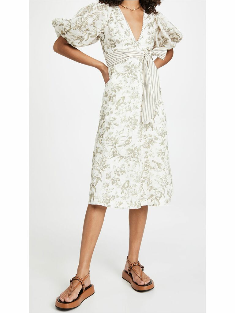 Green and white cottagecore midi dress with puff sleeves and mixed floral and striped patterns