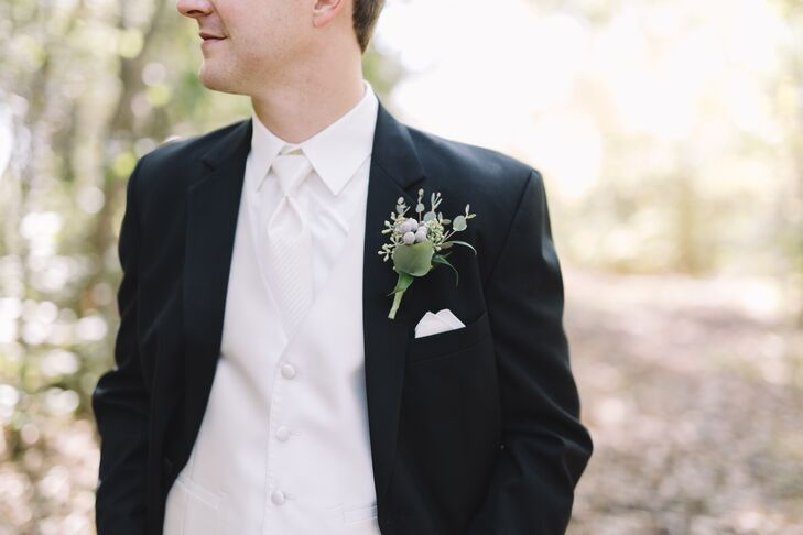 """When Oriana suggested gray suits for the groom and groomsmen, Adam """"had a strong opinion"""" that the men wear tuxes with ties rather than bow ties. Their boutonnieres were eucalyptus and silver brunia."""
