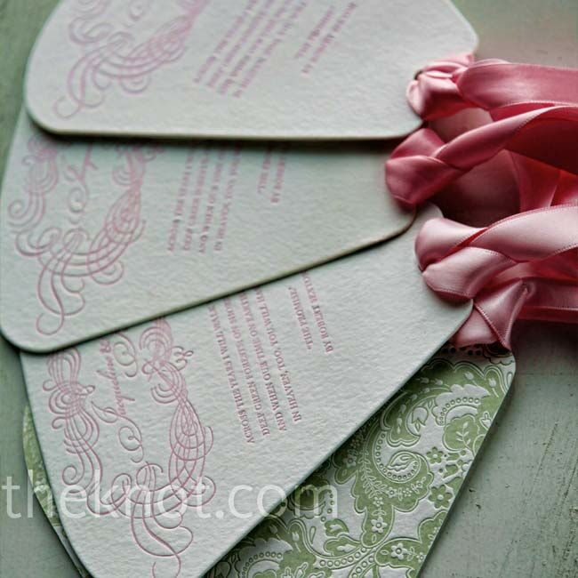 Fans with an intricate green pattern, pink ribbon, and the same fonts used in the invitations took the place of more traditional programs.