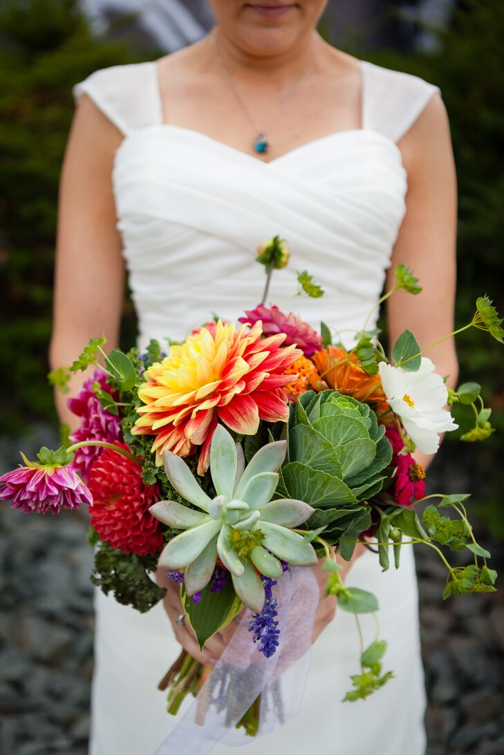 Anna carried a totally cool bouquet for her rustic, vintage wedding. Florist Mickey O'Kane included a cabbage along with more traditional dahlias, succulents, zinnias and wildflowers. We loved the pop of color and bold texture.