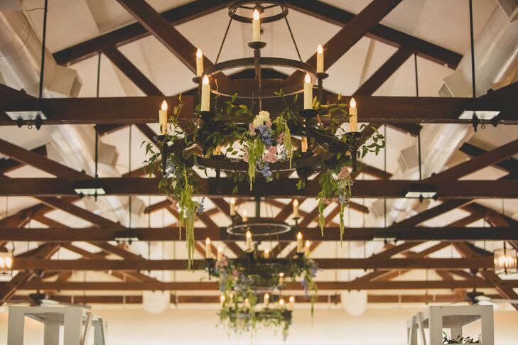 Jenna and Joshua decorated the candelabra chandeliers with hanging amaranthus, pink roses and blue stock flowers. The exposed wood beams across the cathedral ceiling of the hall matched perfectly with their lowcountry theme.