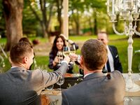 Two grooms giving their toasts at their modern farmhouse wedding.