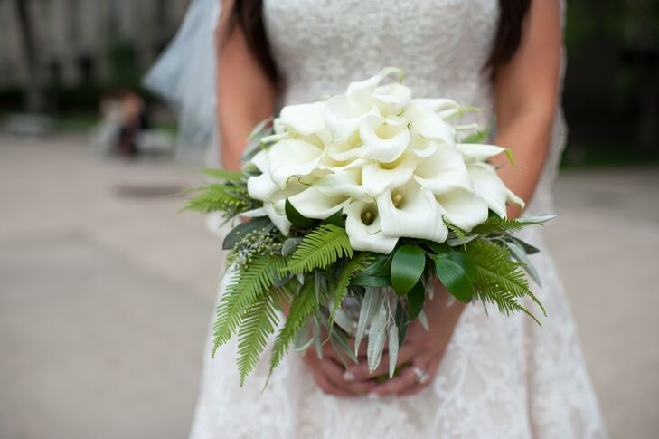 """""""My bouquet and my groom's boutonniere were both made up of lilies,"""" Marisa says. """"I loved the simple lines and how it flowed with the space."""""""