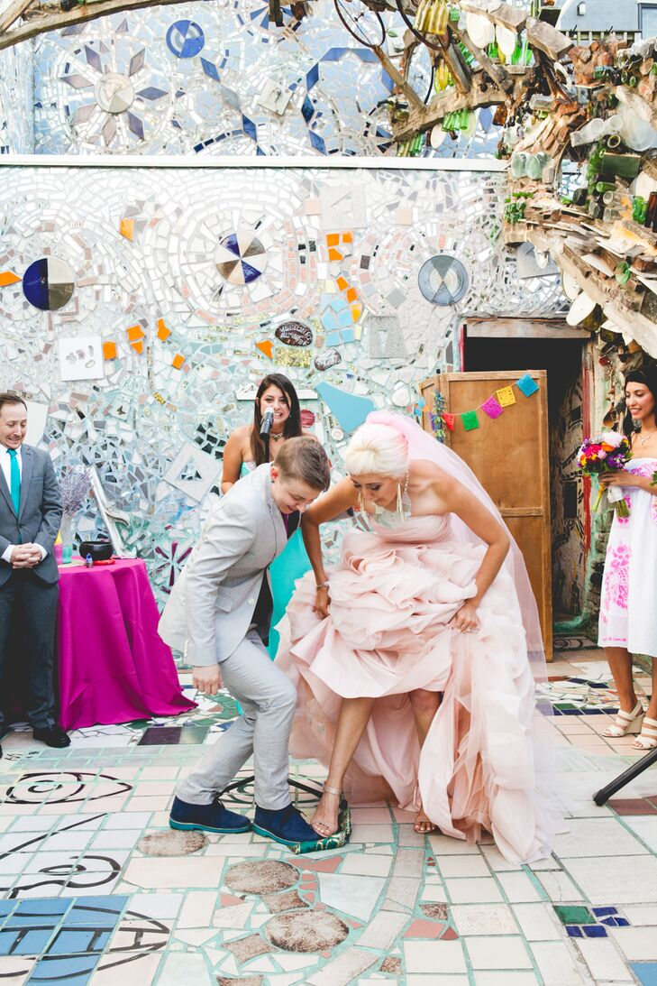 """Since Jeannine is Jewish it felt respectful for us to include the tradition of breaking a glass at the ceremony's end,"" says Robin. ""We did so with a twist – we stepped on the fabric wrapped glass together."""
